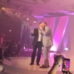 Mike on stage at a corporate event in Birmingham Hilton