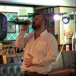 Mike singing at the Anson